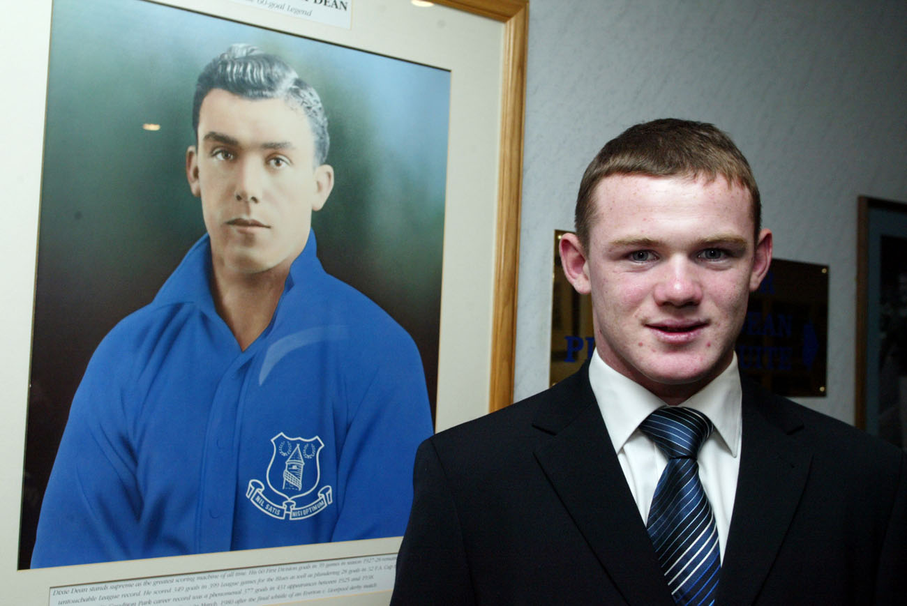 Wayne Rooney 17 January Wayne Rooney then aged poses in front of a portrait