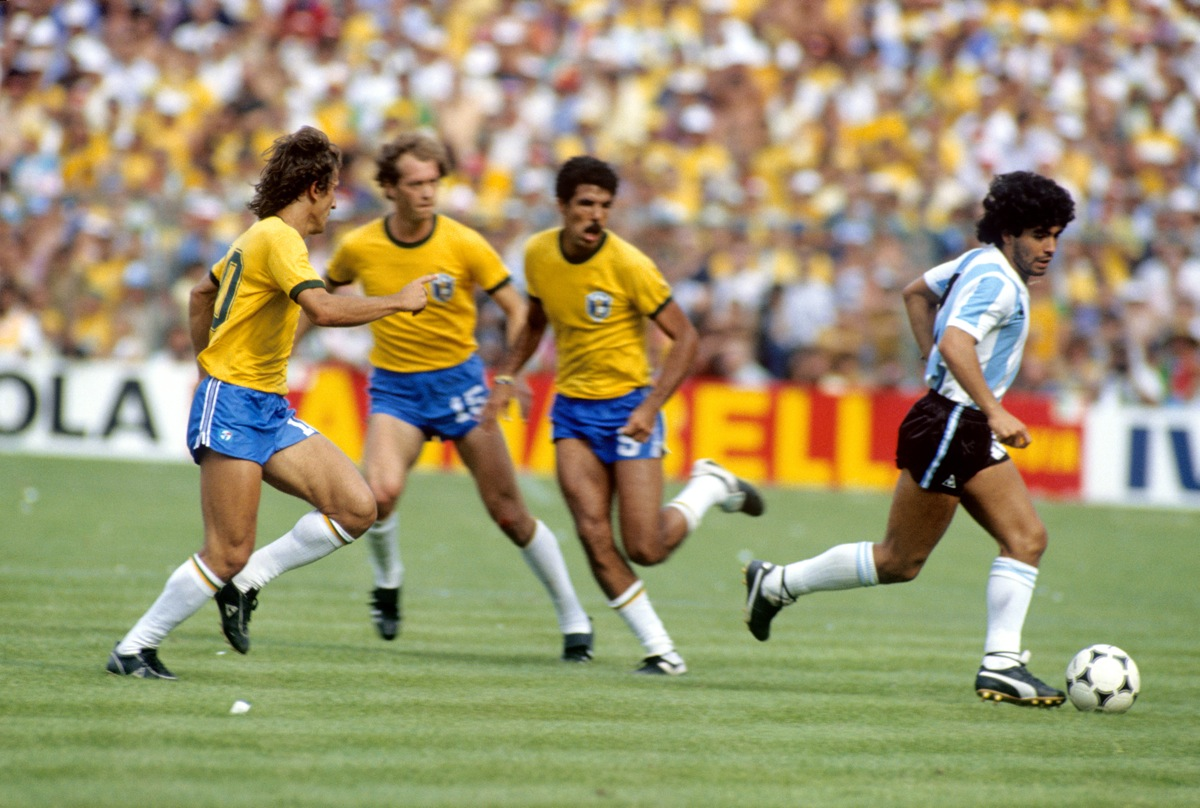 Diego Maradona is watched by three Brazilian players during Brazil's