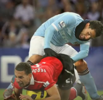 Carlos Tevez Fists Rio Ferdinand In Glorious HD (Video)