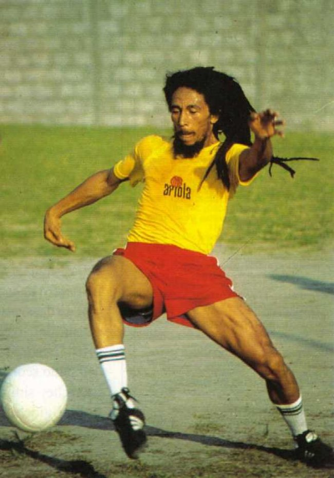 Bob Marley and the Wailers play football at an empty stadium in Brussels while waiting to sound check before kicking off the Belgian leg of the Exodus Tour,
