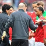 Football GIF: Luis Suarez Ducks Patrice Evra Handshake On Endless Repeat
