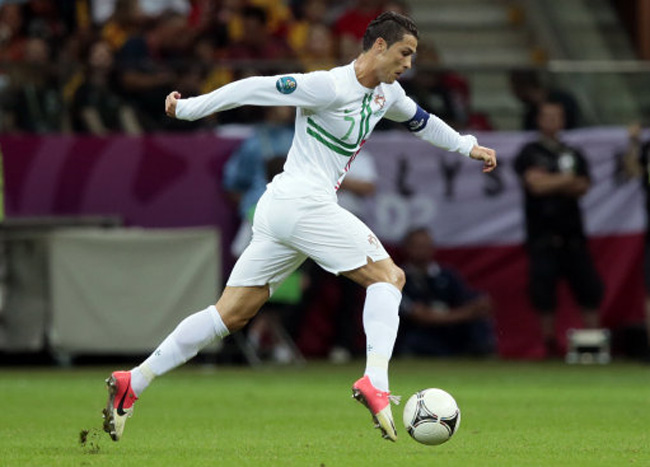 Portugal's Cristiano Ronaldo runs with the ball during the Euro 2012 soccer  championship quarterfinal match between Czech Republic and Portugal in  Warsaw, ...