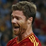 Football GIFs: Xabi Alonso Pushes Javi Martinez Out Of Euro 2012 Winners&#8217; Photo, Gets Squiffy, Falls Over