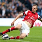 Football GIF: Per Mertesacker Spirals Out Of Control Into 360 Knee Slide