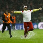 Football GIF: Pitch Invader Rather Damp 'Klinsmann' Dive On Waterlogged Pitch (Poland P-P England)