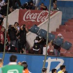 Hell Breaks Loose In Crowd At Copa Sudamericana Match, Two Players Sent Off For Kicking Fans And Riot Police (Video)