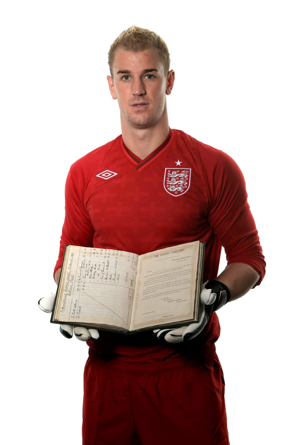Joe Hart holting the rules of football book