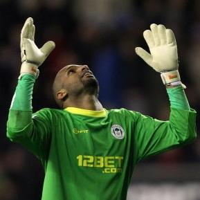 Football GIF: O-Man! Wigan's Ali Al-Habsi Makes A Hash Of A High Ball Against Reading