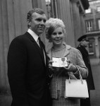 Bobby Moore leaves Buckingham Palace with his wife Tina after receiving his insignia as an officer of the British Empire (OBE), 1967.
