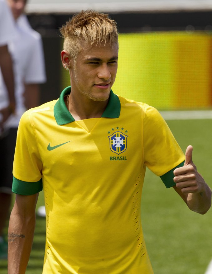 Brazil soccer player Neymar models the new national soccer team jersey