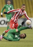 Rubin Kazan's Bebras Natcho sort of gets stuck in on Atletico Madrid's Mario Suarez.