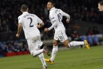 Moussa Dembele celebrates after putting Tottenham through with a late drive. See if you can spot Gareth Bale somewhere in this picture.