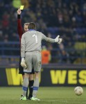 Belgian referee Serge Gumiene shows sometimes you've got to be Krul to be kind.