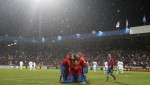 Viktoria Plzen players huddle after racking up a 5-0 aggregate win over Napoli.