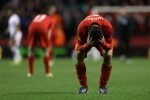 Luis Suarez holds his head in his hands after dragging Liverpool to the brink of victory.