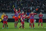 Steaua Bucharest players erupt after winning their penalty shootout against Ajax.