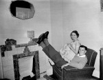 Fulham's Bobby Robson relaxes (despite looking awfully uncomfortable!) at home with his lovely wife Elsie, 1955