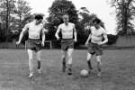 England trio Bobby Robson (L), Ron Flowers and Dennis Viollet (R) go 'skins' for a training session at Roehampton Sports Ground ahead of a friendly against Yugoslavia, 1960