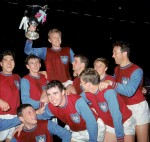 A West Ham team consisting of Moore, Martin Peters and Geoff Hurst celebrate after beating 1860 Munich 2-0 to lift the European Cup Winners Cup in 1965