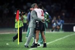 Bobby Robson and Paul Gascoigne embrace on the pitch after England beat Cameroon to reach the semi-finals of the 1990 World Cup.