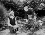 Bobby Moore and wife-to-be Tina tend to the garden of their new home at Gants Hill, Ilford, Essex, 1962.