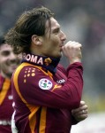 Totti celebrates his goal against Livorno with a now-trademark thumb suck in a nod to his newborn son, Cristian, in 2006