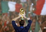 Totti holds the World Cup aloft in front of an adoring, partisan crowd gathered at the Circus Maximus in Rome, 2006