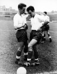 Brian Clough has a quiet word with fellow striker Jimmy Greaves during an England training session at Highbury, 1959