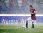 Totti is caught in the deluge during Roma's rather damp and latterly postponed Serie A tie with Sampdoria, 2008