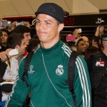Lookin' Good Sweetheart: Cristiano Ronaldo Sashays Through Manchester Airport In Knee High Socks