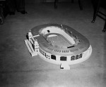 Folks gather to see a model of how Wembley Stadium will look following a £500,000 refit, 1961