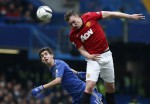 Things get ugly as Phil Jones beats Oscar to a high ball