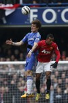 David Luiz gets up above Nani to head the ball clear