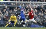 Phil Jones hurtles in to block a shot from Eden Hazard