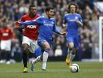 Eden Hazard prances away from Patrice Evra