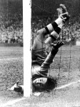 Racing Club de Paris goalkeeper Landi gets down to make an uncomfortable-looking save against Arsenal, 1948