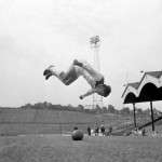 Charlton's Brian Kinsey somersaults over a football as he limbers up at The Addick's pre-season training session at The Valley, 1965