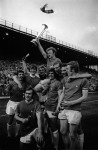 Leeds captain Billy Bremner holds the trophy aloft after winning the 1971 tournament