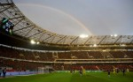 A rainbow is seen above the AWD Arena as Hannover 96 slug it out against Borussia Dortmund