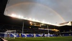 A rainbow forms a colourful corona above the East Stand at White Hart Lane