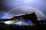 A rainbow forms over the stands at a flooded Gay Meadow, home of Shrewsbury Town