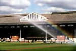 A sprinkler creates a rainbow as the pitch at Craven Cottage is tended to