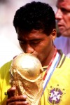 "Romario kisses the World Cup's big golden bulb having beaten Italy in the '94 ""Baggio"" final"