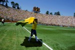Romario parades a Brazilian flag around Stanford Stadium after scoring the only goal of the game against the hosts at USA '94