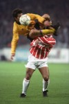 Romario almost has his head taken off by an airbourne Vaios Karagianis of AEK, 1992