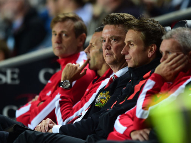 Manchester United's Manager Louis van Gaal sits dejected during the game