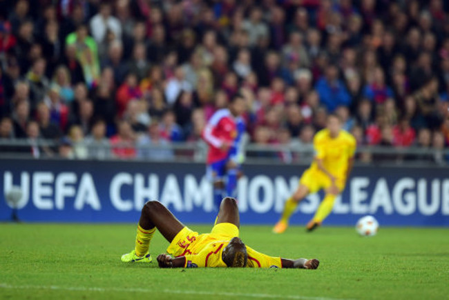 Liverpool's Mario Balotelli lies on the ground frustrated