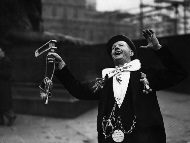 29th April 1939:  A Portsmouth Football Club supporter cheering his team in Trafalgar Square, London, before their FA Cup Final match against Wolverhampton Wanderers at Wembley Stadium.  (Photo by Stephenson/Topical Press Agency/Getty Images)