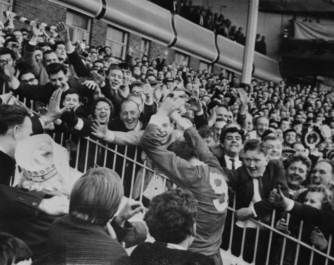 Liverpool centre-forward Ian St John is cheered by fans as he leaves the field after his team beat Chelsea 2-0 in the F.A. Cup semi-final at Villa Park, Birmingham, 28th March 1965. (Photo by Keystone/Hulton Archive/Getty Images)