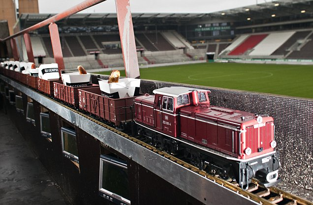 pictured: German footie club FC St Pauli is offering special supporter seats in its ground complete with your own beer pump, flat screen tv and a model railway which delivers freshly cooked sausages to hungry supporters.